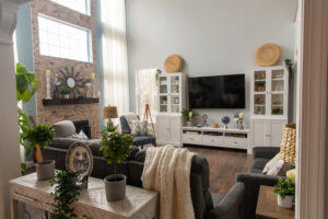 Living area with couch and cushioned chairs