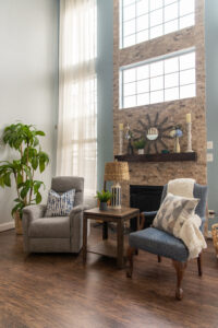 Brick fire place with chairs in living area